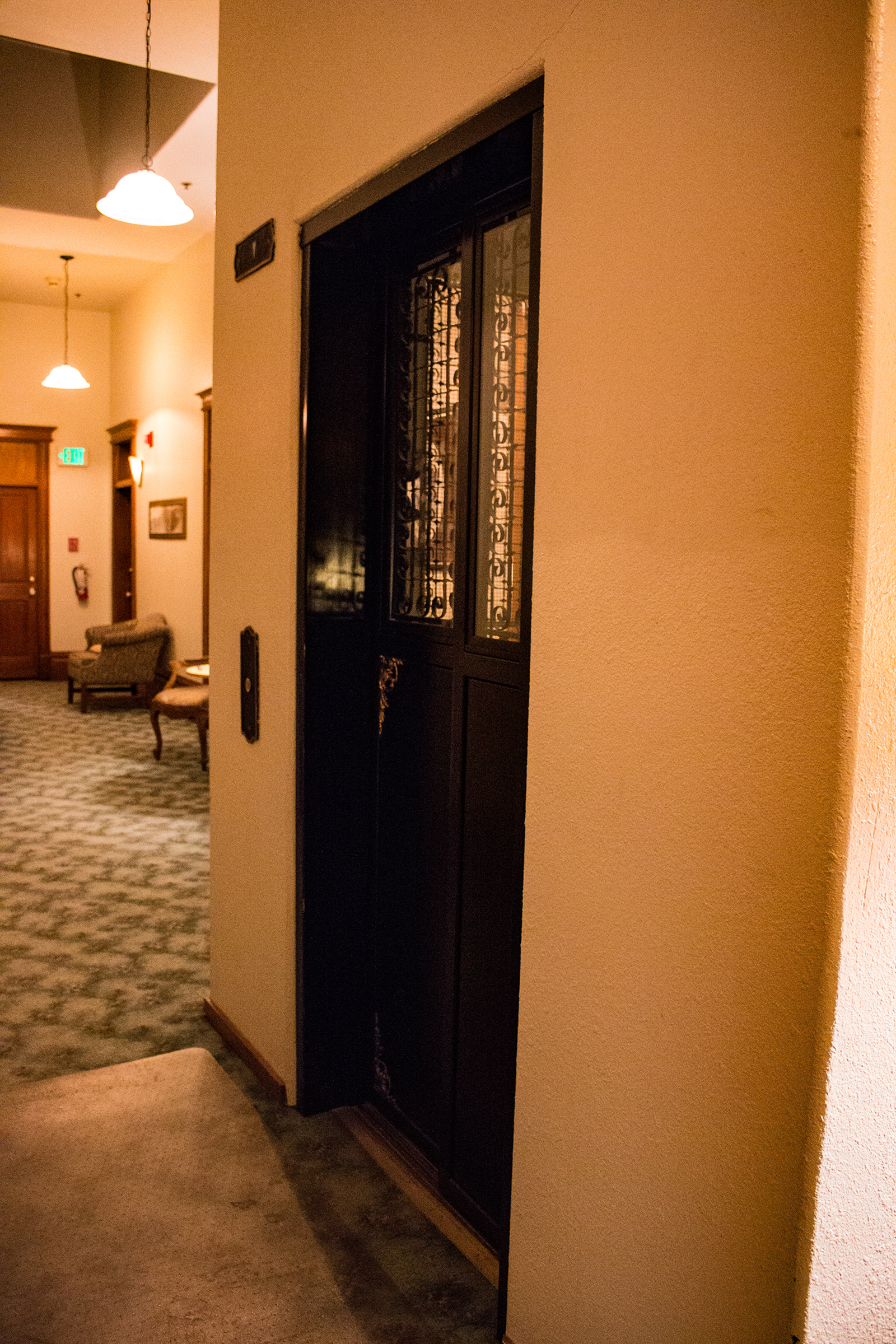 the historical bird cage elevator at the Victor Hotel